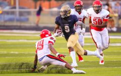 AHS Football standout Kenny Walker is gaining yards and scholarships