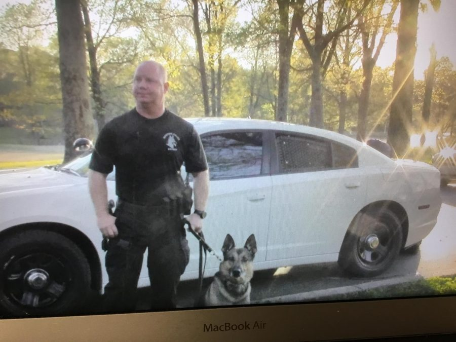K9+Unit+standing+with+his+Partner